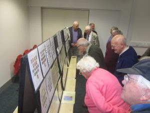 NPS Members inspecting the displays