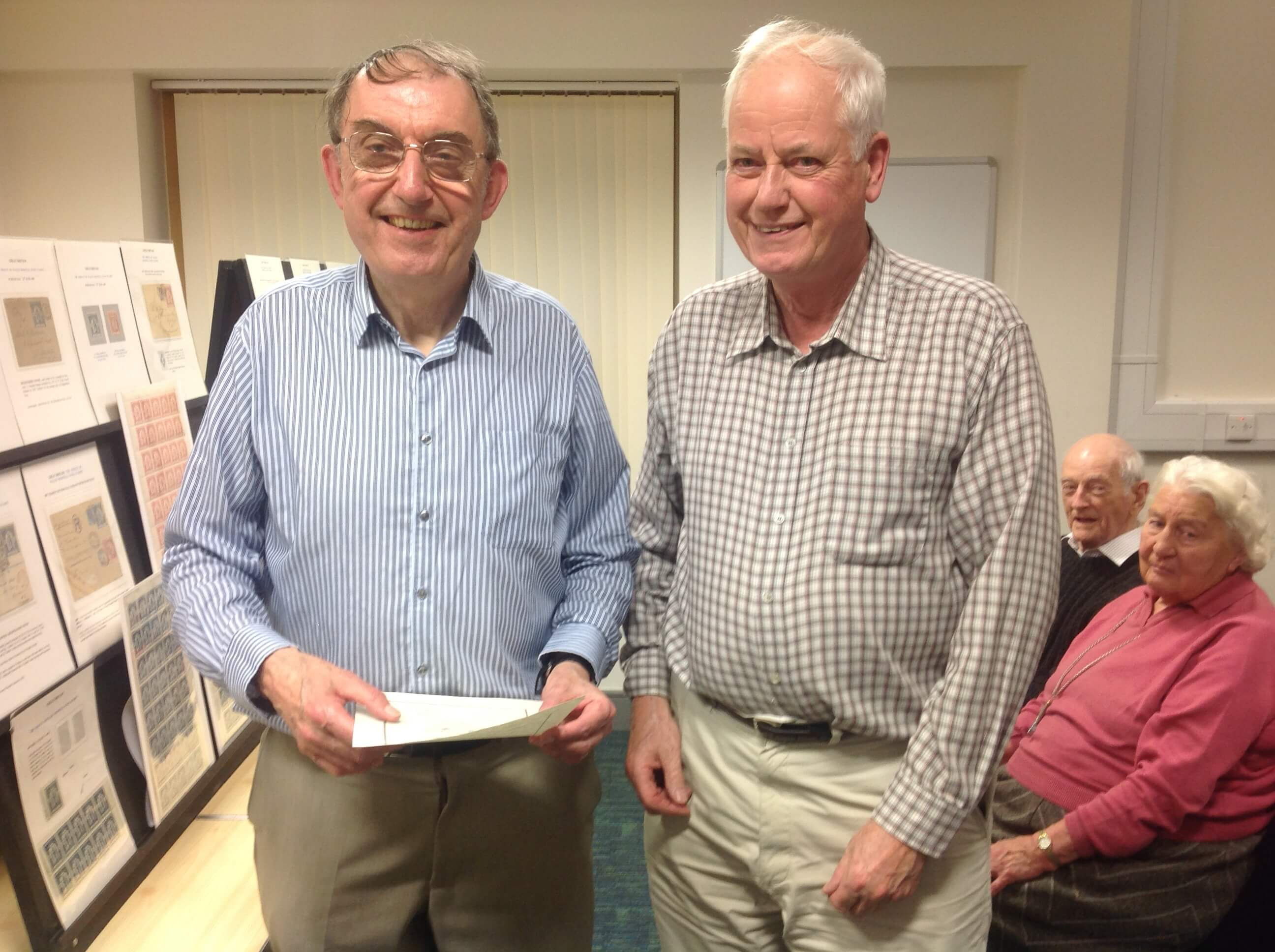 Dr David Sigee being presented with a certificate by Nick Rolfe