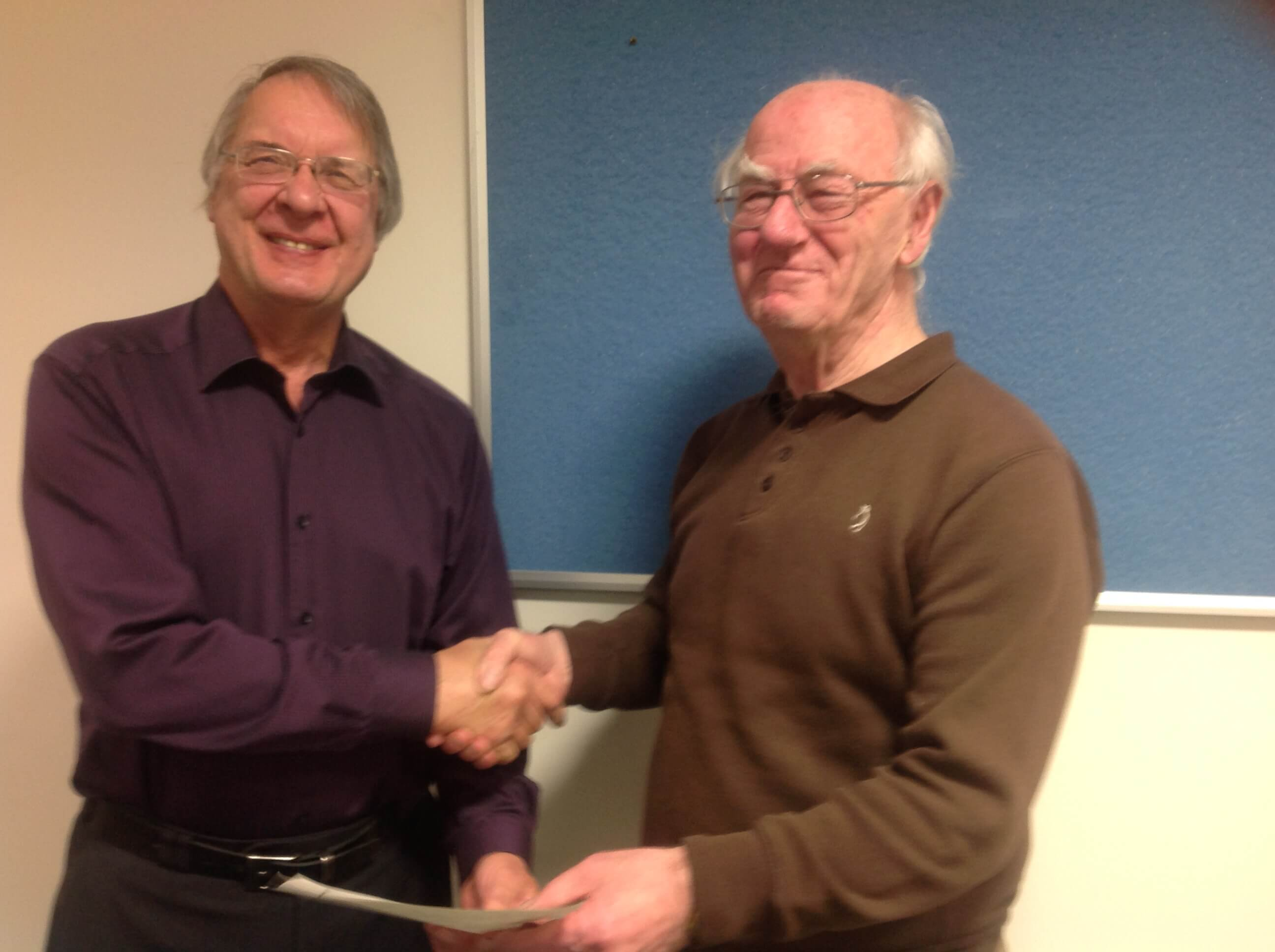 John Mayne receives a certificate from Graham Macpherson for his display